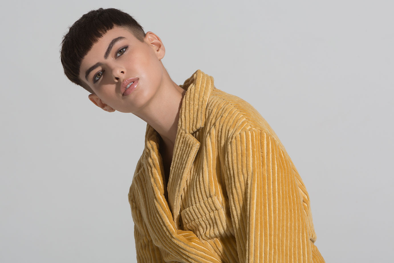 New York fashion photographer Eric Hason photographs model Hayden Graye from State Management wearing a gold corduroy jacket by Land of Distraction for Basic Magazine.